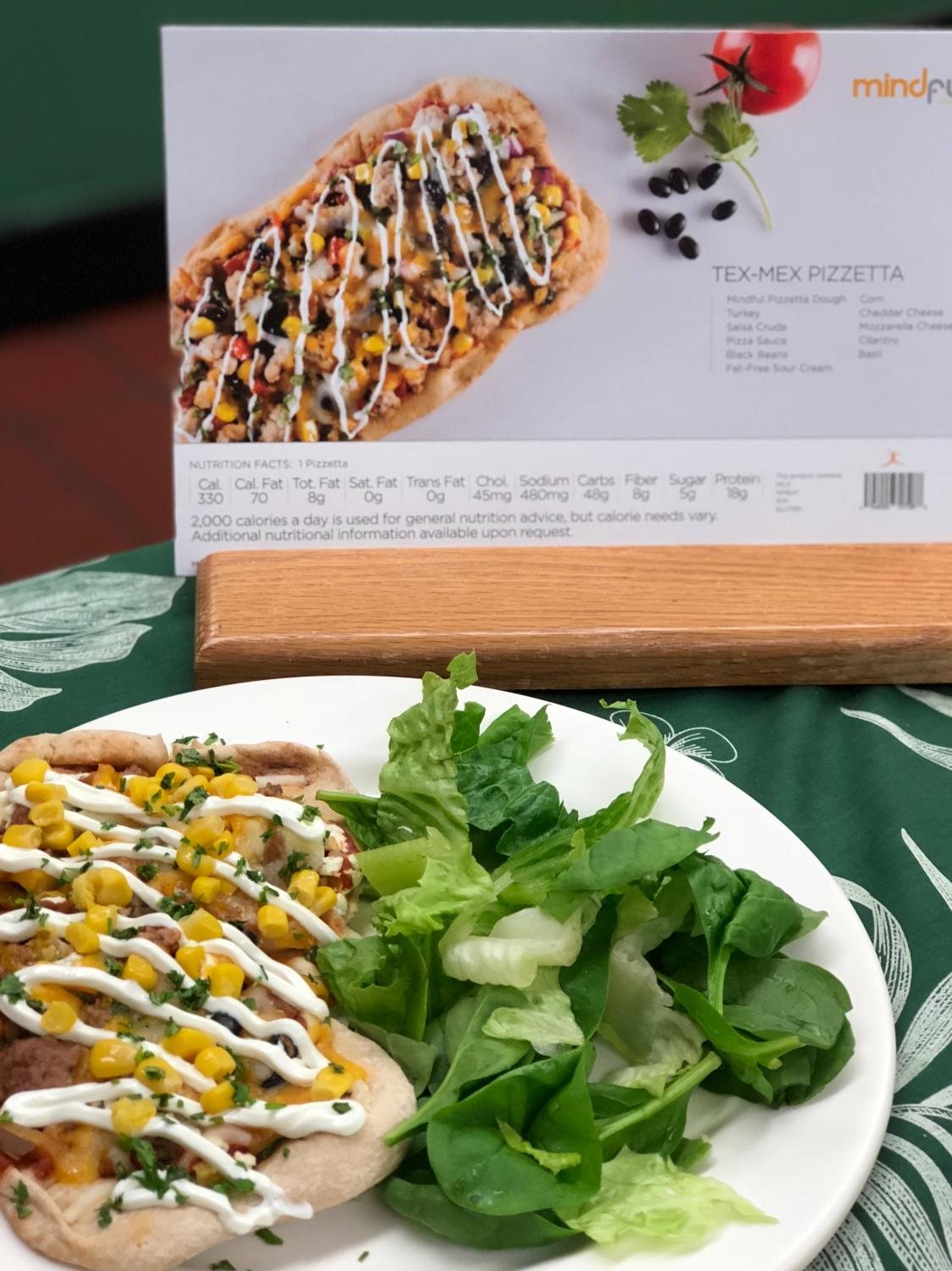 The school cafeteria is offering healthier options such as Tex-Mex pizza this year.