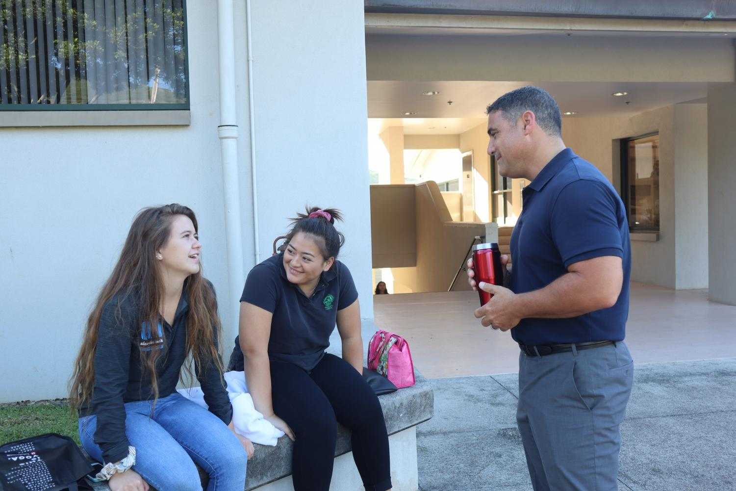 High School Principal Paul Passamonte meets with high school students.