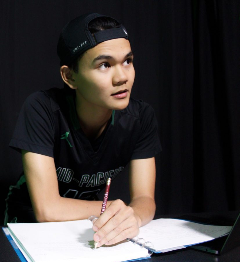 Student athlete and full IB student Micah Suan, grade 12 balances school and sports.  Photo by staff photograph Abigail Yagi.