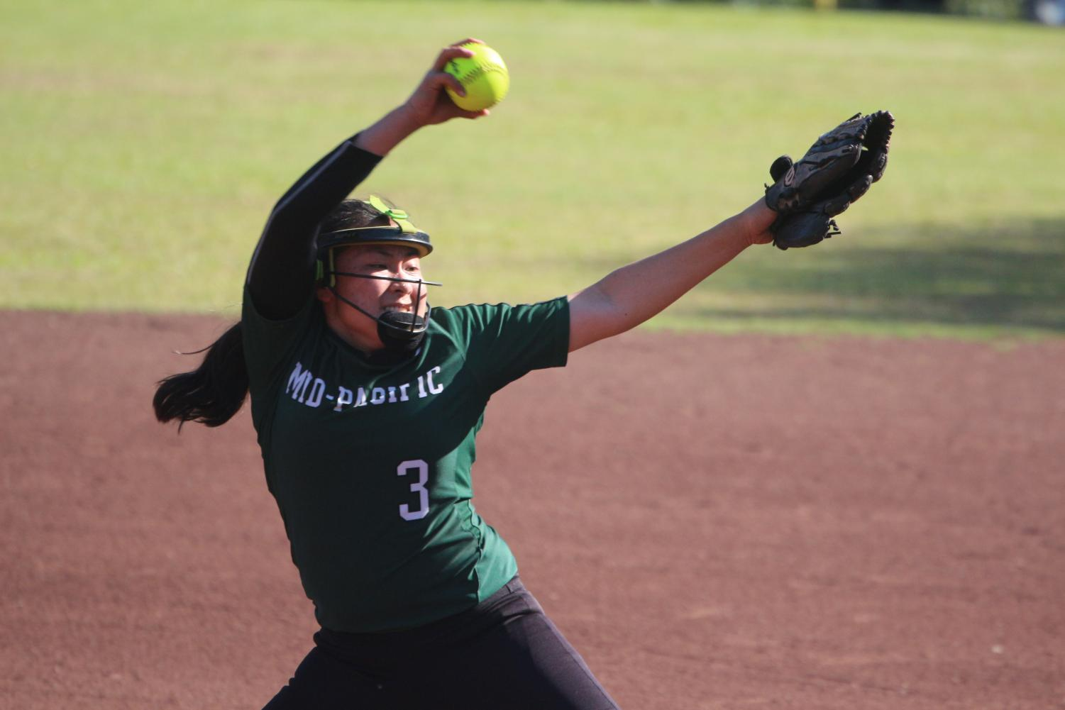 Player Darian Kanno pitches a ball to the opponent team