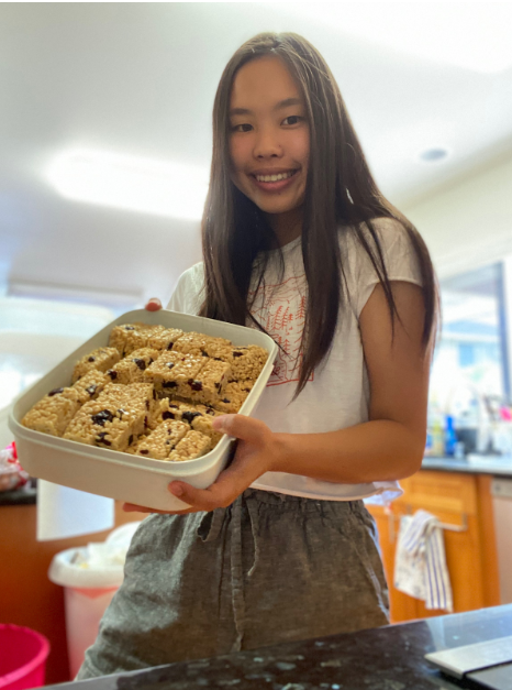 Kaci Muromoto showcasing the craisin energy bars she made. Muramoto has made cooking her routine since the stay-at-home order started.