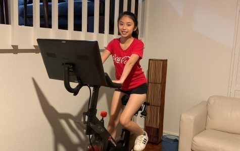 Sophomore Shelby Honda exercises at home. PE teachers have changed their curriculum to encourage at-home workouts.