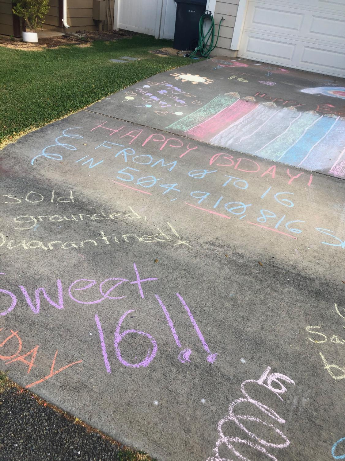 A driveway decorated for a drive-though sweet 16 birthday party. Students have found other ways to celebrate milestone events during the stay at home order.