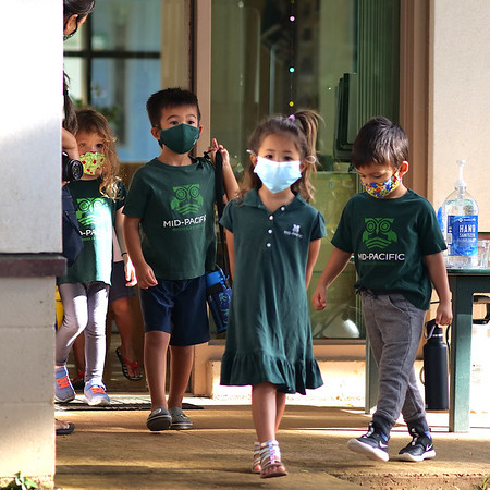 Preschool and kindergarten students walk to class with their masks all six feet apart. The preschool and kindergarten students returned to campus after their extended summer break. Photo by Associate Director of Communications Scot Allen.