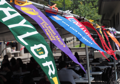 The banners of different colleges blow in the wind in unison during Mid-Pacific