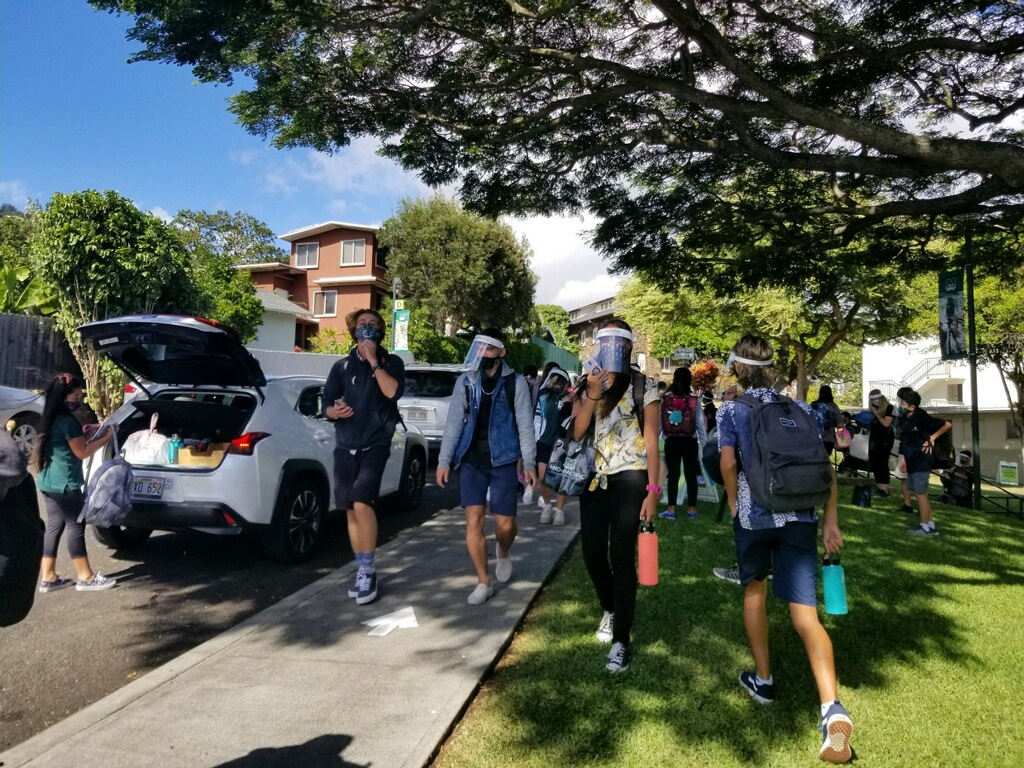 Students walking with their masks and face shields on their first day back to school in-person. Mid-Pacific opened campus up to ninth graders on Nov. 9 and staggered the rest of the grades
