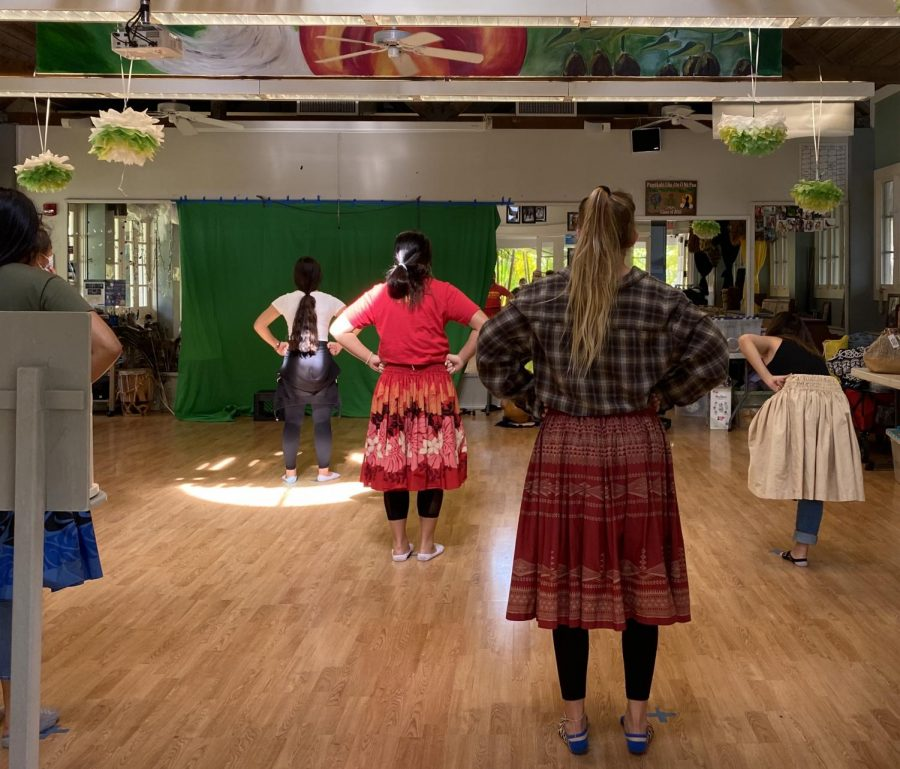 Hula students standing in ready position six feet apart from each other. Mid-Pacific's hula program is not deeply affected by social distancing guidelines.