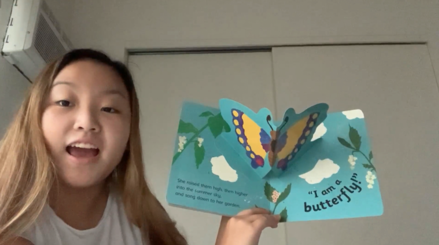 Senior and Interact Club president Alyssa Chun reading a children's book aloud in a video.The Interact Club participated in a service project where they read aloud in a video for kids to access on Hawaii Literacy's Instagram.