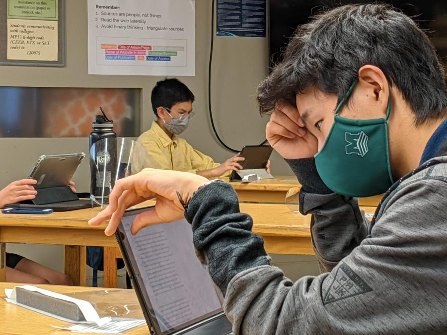 Freshman Junsei Tanizaki concentrates on his assignments as in Christopher Falk's English Humanities class. Final exams for semester 1 were cancelled this school year due to the virtual learning program and COVID-19.