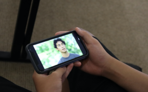 A Mid-Pacific student watches the IGTV series, Chat Sessions during school. 2019 alumni Kira Morimoto directed this series and interviews former students to talk about their favorite school.