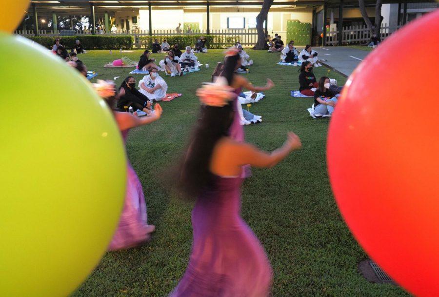 Pupukahi+dancers+perform+for+the+Aloha+Program+as+senior+watch+socially+distanced+on+mats.+