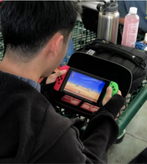 Michael Tam, an 11th grader plays on the Nintendo Switch last year. Increased screen time has made some people question whether teenagers are in front of their screens too much.