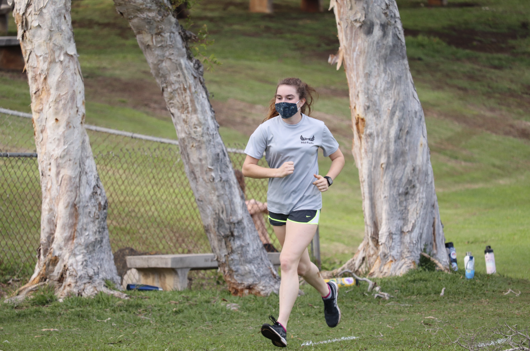 Sophomore Quinn Gilman runs during cross country practice. Virtual races are happening during the pandemic.