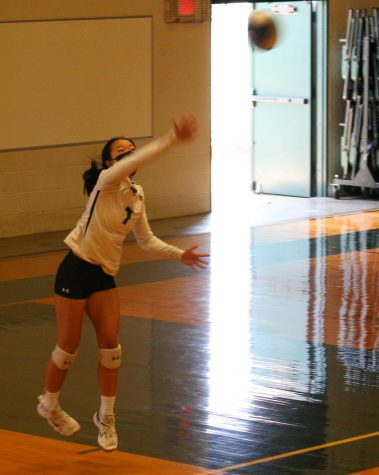 Senior #7, Alyssa Muraoka servers the ball during her senior game. Muraoka was one of six athletes committed playing on the starting team for girls volleyball.